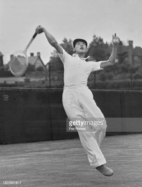 Choy Wai-Chuen from the Republic of China jumps to make an overhead smash return against during a Men's Singles match at the Frinton Lawn Tennis...