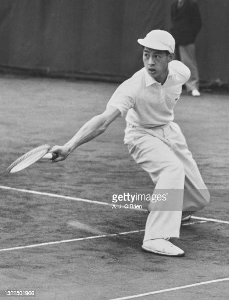 Choy Wai-Chuen from the Republic of China plays a backhand return against compatriot Kho Sin-Kie in their Men's Singles Final match at the British...