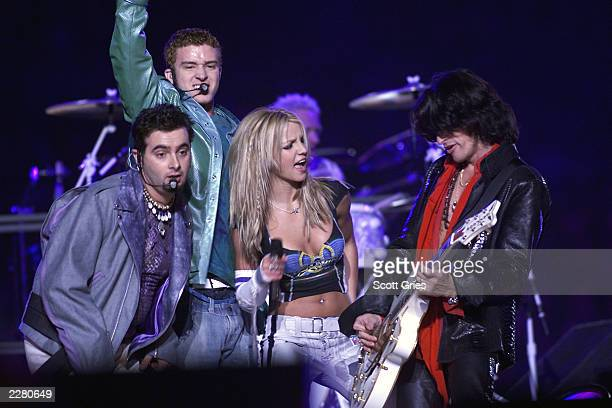 Chric Kirkpatrick and Justin Timberlake of NSYNC join Britney Spears and Joe Perry of Aerosmith on stage during MTV's Superbowl halftime show at...