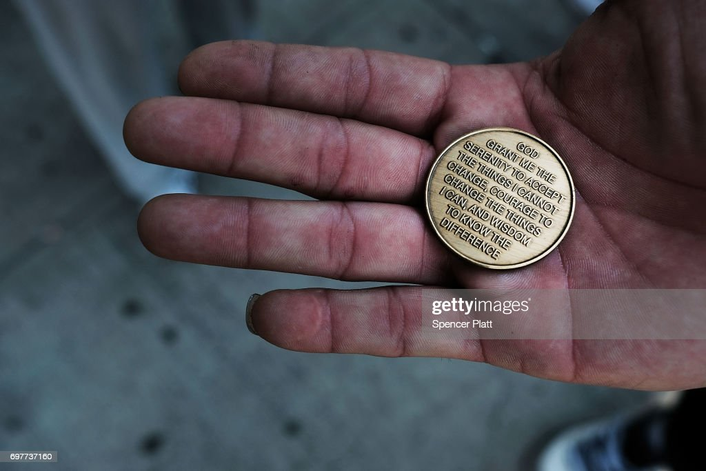 Chris, a patient at a Brooklyn methadone clinic for those addicted to heroin, displays a Serenity Prayer coin he carries with him in his fight with addiction on June 19, 2017 in New York City. Newly released data shows that over 1,370 New Yorkers died from overdoses in 2016, the majority of those deaths involved opioids. According to the Deputy Attorney General, drug overdoses are now the leading cause of death for Americans under the age of 50.