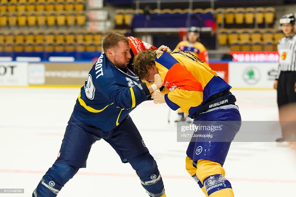 Chris Abbott #29 of HV71 Jonkoping mixes it up with Ilmari Pitkanen #73 of Lukko Rauma, during the Champions Hockey League Round of 32 match between HV71 Jonkoping and Lukko Rauma at Kinnarps Arena on October 4, 2016 in Jonkoping, Sweden.
