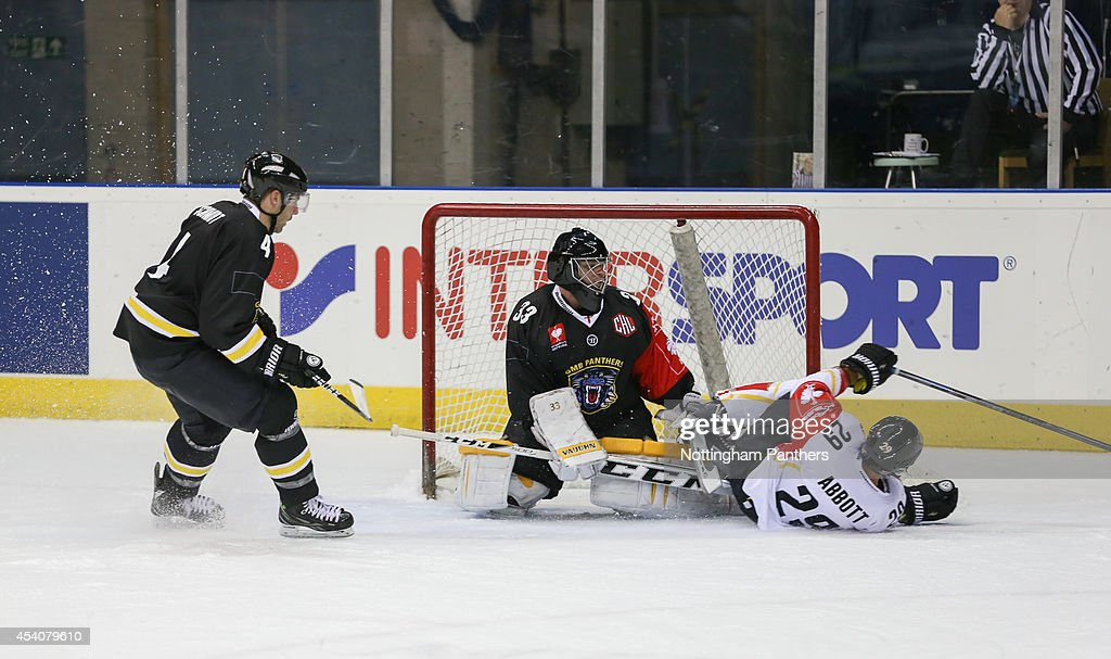 Chris Abbott #28 of Lulea collides with goal tender Craig Kowalski #33 of Nottingham Panthers during the Champions Hockey League group stage game between Nottingham Panthers and Lulea Hockeyat at the National Ice Centre on August 24, 2014 in Nottingham, England.