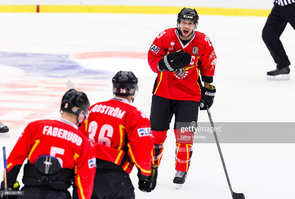Chris Abbott #29 of Lulea Hockey celebrates a goal during the Champions Hockey League quarter final second leg game between Lulea Hockey and Lukko Rauma at Coop Norrbotten Arena on December 9, 2014 in Lulea, Sweden.
