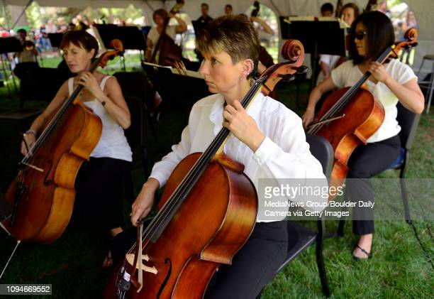 Chris Abbott plays the cello during the Longmont Symphony Orchestra's annual Fourth of July Summer Concert in Thompson Park Saturday July 04 2015