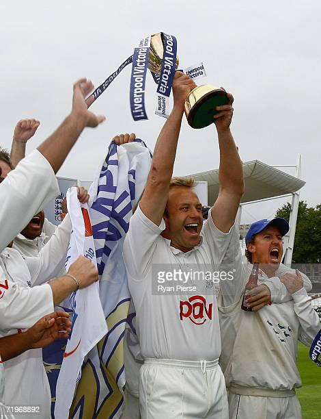 Chris Adams captain of Sussex lifts the trophy after his team were crowned champions during the Liverpool Victoria Insurance County Championship...