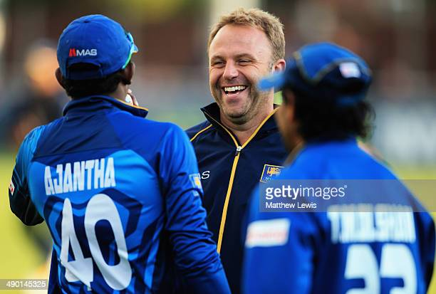 Chris Adams talks to Ajantha Mendis of Sri Lanka after he is consulting for the Sri Lankan cricket team whilst on the Tour of England during a Tour...