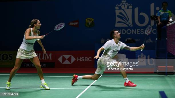 Chris Adcock and Gabrielle Adcock of England compete against Yuta Watanabe and Arisa Higashino of Japan during the Mixed Doubles Round 2 match on day...