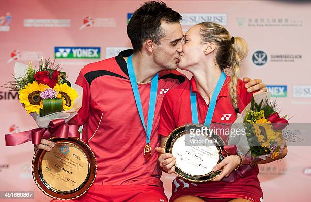Chris Adcock and Gabrielle White of England pose with their trophies on the podium after winning the mixed doubles final against Liu Cheng and Bao...