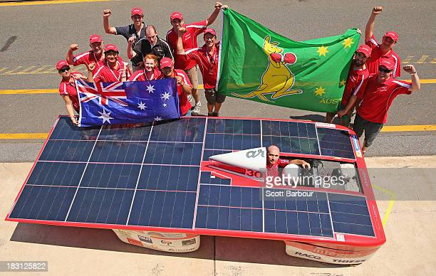 Chris Ahearn, driver of Arrow1 from Team Arrow, Associated with Queensland University of Technology in Australia along with team members pose after...