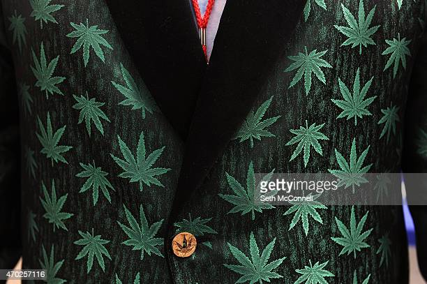 Chris Alford of Austin Texas sports a marijuana themed smoking jacket during the High Times Cannabis Cup at the Denver Mart in Denver Colorado on...