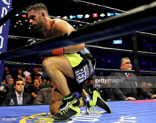 Chris Algieri get up slowly after being knocked down in the fifth round against Errol Spence Jr during their welterwieght bout at Barclays Center on...