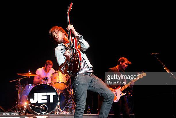 Chris and Nic Cester and Mark Wilson of Jet perform on stage at Rod Laver Arena on 14th December 2009 in Melbourne Australia