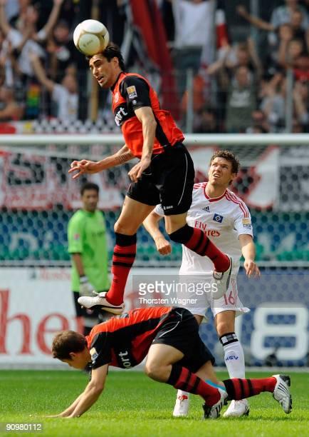 Chris and Pirmin Schwegler of Frankfurt battles for the ball with Marcus Berg of Hamburg during the Bundesliga match between Eintracht Frankfurt and...