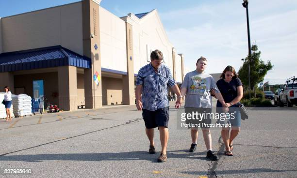 Chris and Sue Landreth restrain Ethan Poulin's arms after a brief violent outburst inside Lowe's Home Improvement store Poulin is diagnosed with...
