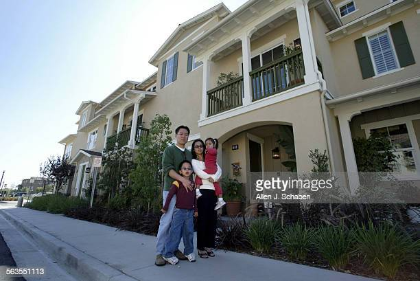 Chris and Truc Le with their kids Evan left and Sydney in front of Tustin Field's Amelia model a John Laing development which is the same 3 bedroom 3...