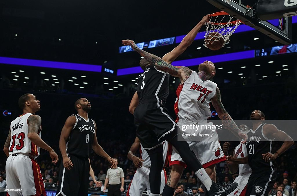 Chris Andersen #11 and Shabazz Napier #13 of Miami Heat vie with Jerome Jordan #9, Alan Anderson #6 and Cory Jefferson #21 of Brooklyn Nets during a basketball game between Miami Heat and Brooklyn Nets at the Barclays Center on December 16, 2014 in the Brooklyn Borough of New York City.