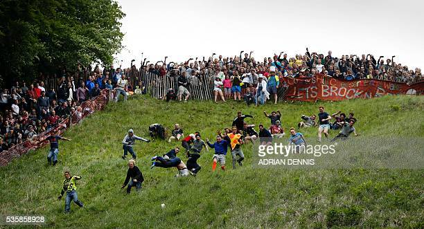 Chris Andersen gets ahead of his fellow competitors as they tumble down Cooper's Hill in pursuit of a round Double Gloucester cheese during the...
