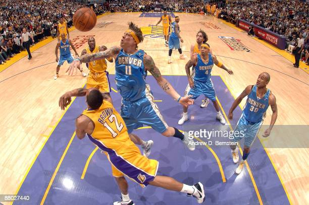Chris Andersen of the Denver Nuggets blocks the shot of Trevor Ariza of the Los Angeles Lakers in Game Five of the Western Conference Finals during...