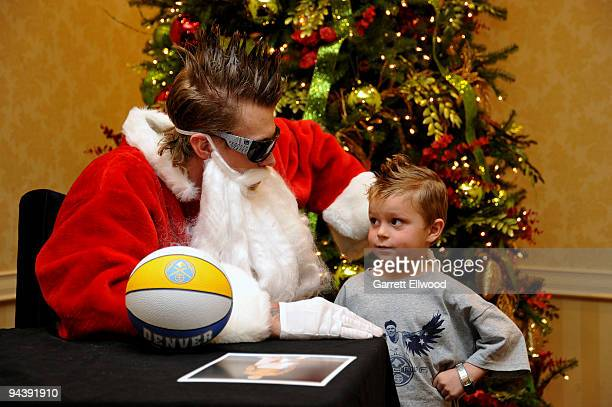 Chris Andersen of the Denver Nuggets dresses as Santa Claus and signs autographs to benefit the Alliance for Choice in Education during the Denver...