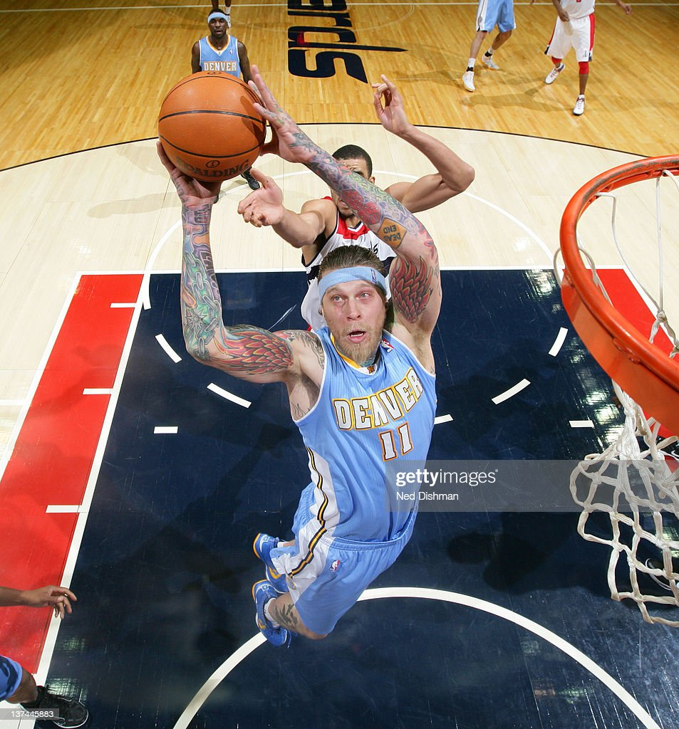 Chris Andersen #11 of the Denver Nuggets dunks against JaVale McGee #34 of the Washington Wizards during the game at the Verizon Center on January 20, 2012 in Washington, DC.