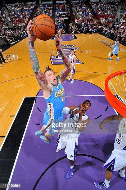 Chris Andersen of the Denver Nuggets dunks the ball against Jason Thompson of the Sacramento Kings on April 1 2011 at Power Balance Pavilion in...
