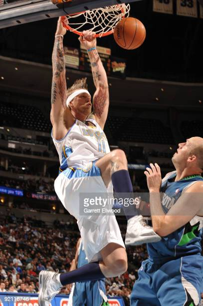 Chris Andersen of the Denver Nuggets goes to the basket against the Minnesota Timberwolves on October 20 2009 at the Pepsi Center in Denver Colorado...