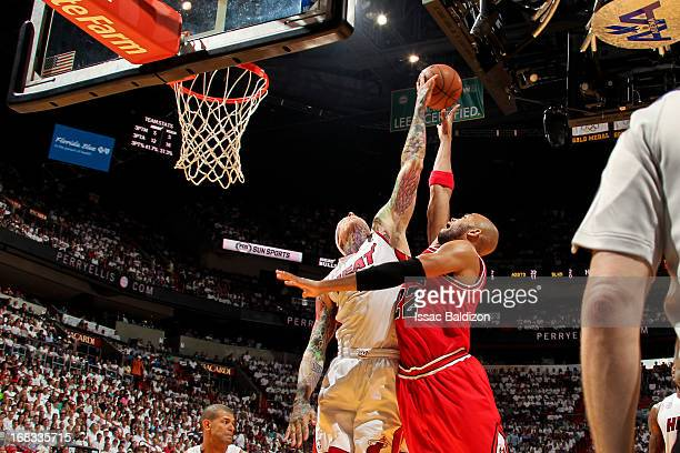 Chris Andersen of the Miami Heat blocks a shot by Taj Gibson of the Chicago Bulls in Game Two of the Eastern Conference Semifinals during the 2013...