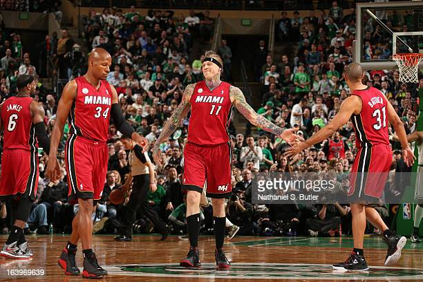 Chris Andersen of the Miami Heat celebrates with teammates Ray Allen and Shane Battier during a game against the Boston Celtics on March 18 2013 at...