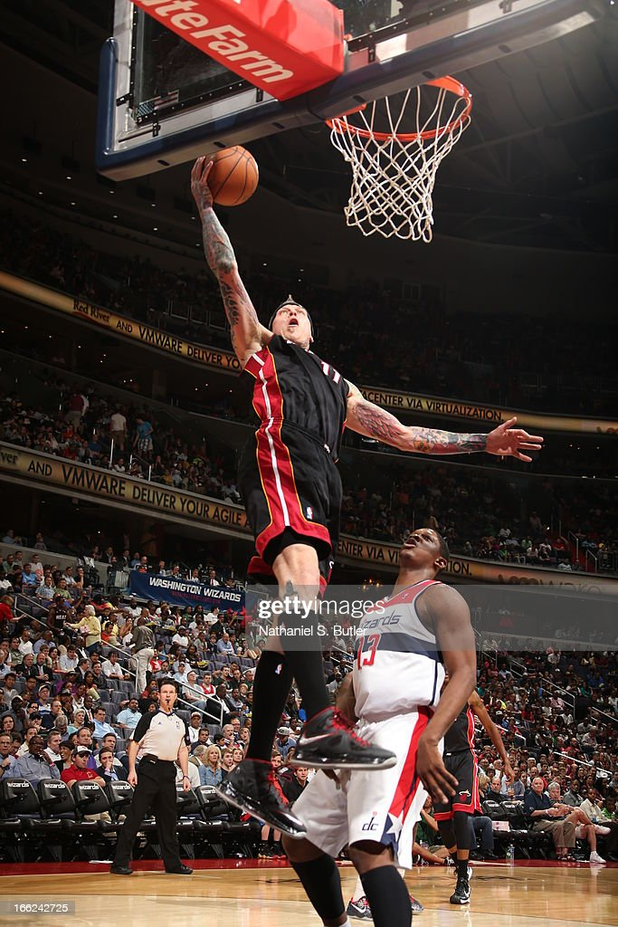 Chris Andersen #11 of the Miami Heat dunks the ball against Kevin Seraphin #13 of the Washington Wizards on April 10, 2013 at the Verizon Center in Washington D.C.