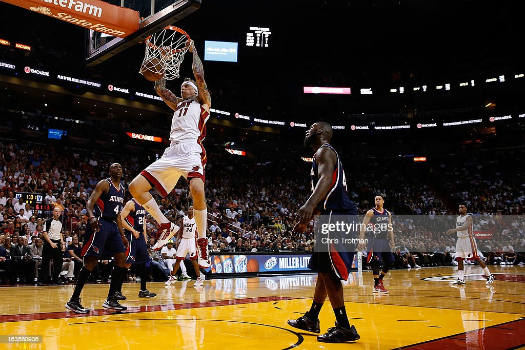 Chris Andersen #11 of the Miami Heat dunks the ball as Anthony Tolliver #4 and Ivan Johnson #44 of the Atlanta Hawks look on at American Airlines Arena on March 12, 2013 in Miami, Florida.