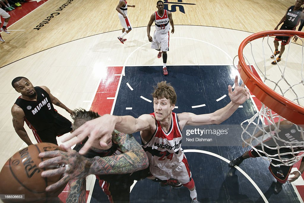 Chris Andersen #11 of the Miami Heat grabs a rebound over Jan Vesely #24 of the Washington Wizards at the Verizon Center on April 10, 2013 in Washington, DC.
