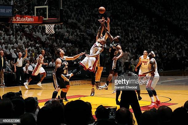 Chris Andersen of the Miami Heat jumps for the rebound against Kawhi Leonard of the San Antonio Spurs in Game Four of the 2014 NBA Finals at American...