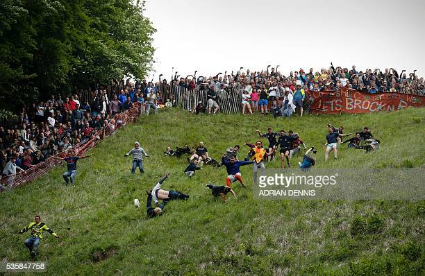Chris Anderson gets ahead of his fellow competitors as they tumble down Coopers Hill in pursuit of a round Double Gloucester cheese during an annual...