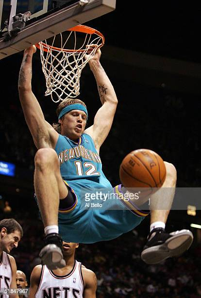 Chris Anderson of the New Orleans Hornets dunks against the New Jersey Nets on December 10 2004 at the Continental Airlines Arena in East Rutherford...