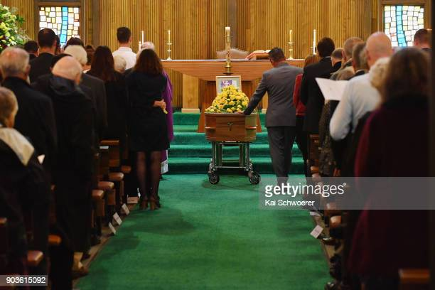 Chris Anderton touches the casket of his father during the funeral service for former Deputy Prime Minister Jim Anderton on January 11 2018 in...
