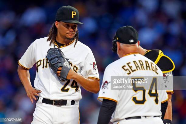 Chris Archer of the Pittsburgh Pirates and pitching coach Ray Searage of the Pittsburgh Pirates talk during a mound visit in the third inning against...
