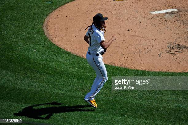 Chris Archer of the Pittsburgh Pirates celebrates after a strike out in the fifth inning against the St. Louis Cardinals at the home opener at PNC...
