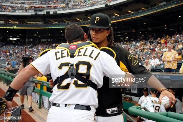 Chris Archer of the Pittsburgh Pirates hugs catcher Francisco Cervelli before the game against the Chicago Cubs at PNC Park on August 1 2018 in...