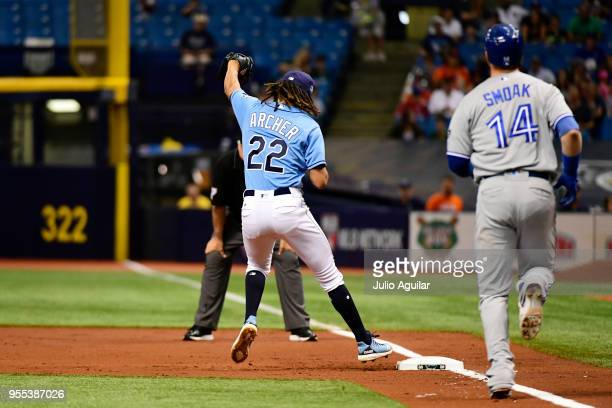 Chris Archer of the Tampa Bay Rays gets an out at first base over Justin Smoak of the Toronto Blue Jays in the second inning on May 6 2018 at...