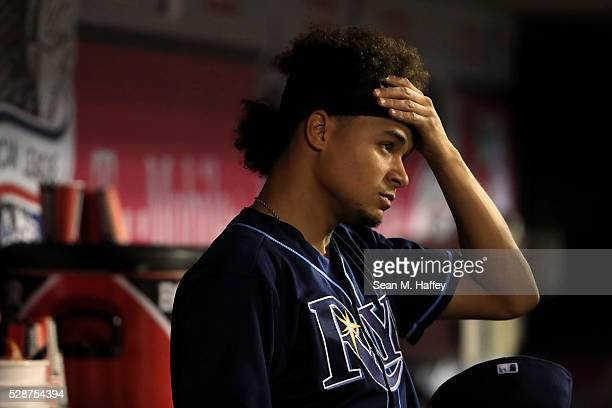 Chris Archer of the Tampa Bay Rays holds his head in the dugout during the third inning of a baseball game between the Los Angeles Angels of Anaheim...