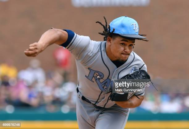 Chris Archer of the Tampa Bay Rays pitches during the game against the Detroit Tigers while wearing a special blue jersey and hat for prostate cancer...