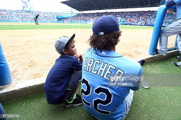 Chris Archer of the Tampa Bay Rays talks to Diego Lopez in the dugout prior to the game against the Cuban National team at Estadio Latinoamericano on...