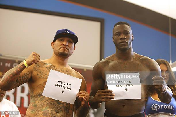 Chris Arreola and WBC World Heavyweight Champion Deontay Wilder pose with His Life Matters signs during their weighin at Legacy Arena at the BJCC on...