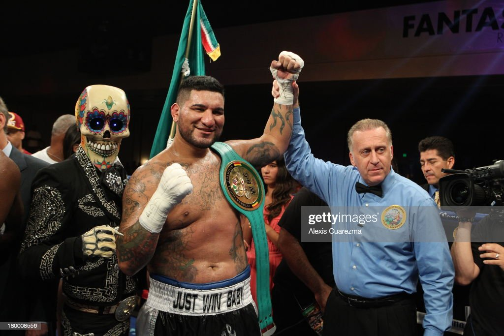 Chris Arreola (C) celebrates his victory over Seth Mitchell as referee Jack Reiss (R) holds his hand up for the WBC International Heavyweight Title at the Fantasy Springs Resort Casino - Special Events Center on September 7, 2013 in Indio, California.