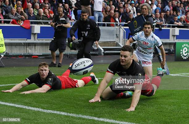 Chris Ashton and Duncan Taylor of Saracens dive for the ball during the European Rugby Champions Cup Final match between Racing 92 and Saracens at...