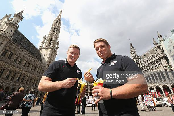 Chris Ashton and John Smit of Saracens eats a bag of traditional Belgian frites in the Grand Place after a Saracens press conference held in the City...