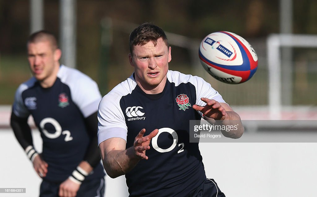 Chris Ashton catches the ball during the England training session held at St Georges Park on February 14, 2013 in Burton-upon-Trent, England.