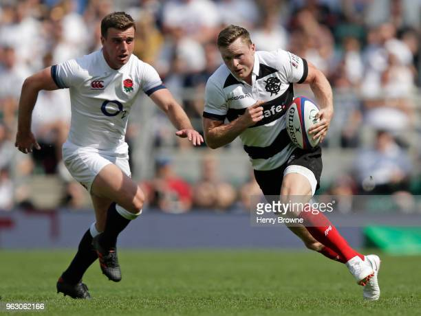 Chris Ashton of Barbarians and George Ford of England during the Quilter Cup match between England and Barbarians at Twickenham Stadium on May 27...