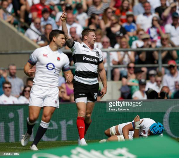 Chris Ashton of Barbarians celebrates after scoring a try during the Quilter Cup match between England and Barbarians at Twickenham Stadium on May 27...