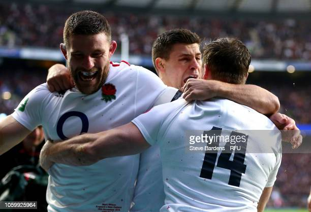 Chris Ashton of England celebrates scoring his sides first try with team mates Mark Wilson and Ben Youngs during the Quilter International match...